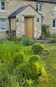 Topiary chicken, long grass, stone cottage