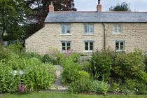 Stone cottage, roses, peonies, Centranthus lecoqii