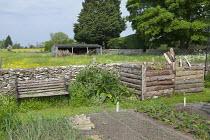 Compost bins, bench, kitchen garden