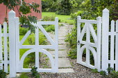 White painted fence, stepping stone path