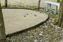 Petanque pitch, boules, bench