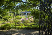View though gate into formal garden, girl statue by Nathan David