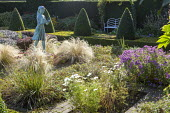Formal garden, box pyramids, girl statue by Nathan David, Stipa tenuissima, view to bench