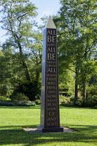 Engraved obelisk on lawn