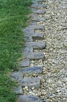 Stone lawn edging, gravel path
