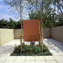 Low-maintenance garden, concrete fountain