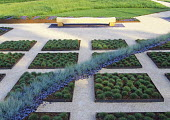 Square steel frames planted with Mossy festuca in steel frames with a blue wave of Festuca glauca running diagonally across,  Westonbirt Garden Festival 2003, design by Anthony Paul