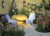 Unusual table and chairs in 'A garden for modern lovers', design by Katherine Kears