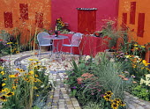 Urban garden with brightly painted walls, Tatton Park Flower Show, design by Jo Capstick and Nicky Saddington.