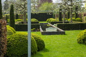 Formal pond between yew hedges, cloud-pruned box hedges