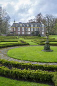 Circular path around circular lawn, statue, view to house, box parterre