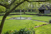 Fountain and pond in formal garden