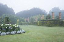 Dahlia 'Suffolk Bride', Salvia farinacea 'Reference', Senecio cineraria 'Silver Dust', yew hedge, brick piers