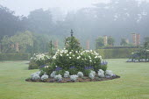 Circular border in lawn with summer bedding, Dahlia 'Suffolk Bride', Salvia farinacea 'Reference', Senecio cineraria 'Silver Dust'