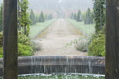 Curtain of water, view along path towards gate