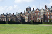View across lawn to Sandringham House, yew hedge