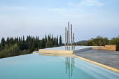 Contemporary aluminium sculpture, 'Towers of Time', in infinity pool