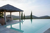 Pavilion by infinity pool, chair