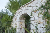 Arch in stone wall, passionfruit