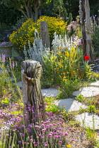 Seaside-themed garden, driftwood, Armeria maritima, Stachys byzantina, Calendula officinalis, Santolina rosmarinifolia