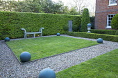 Square lawn, gravel paths, wooden bench, hornbeam hedge, stone balls
