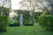 View to obelisk in low clipped box hedge enclosure, hornbeam hedges