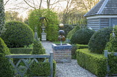 Lead water feature with gold ball, view to berceau with urn, box hedges