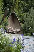 Boat arbour, stepping stones through slate chippings, Luzula nivea, Pinus sylvestris, Larix decidua
