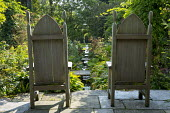 Gothic wooden chairs on patio overlooing rill stream, stone bridges