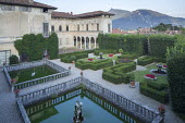 Formal Italian garden, low clipped box hedge parterres, gravel paths, square pools with stone balustrades
