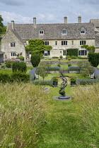 View across formal sunken garden, lavender borders, Taxus baccata, sculpture