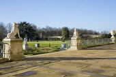 View from terrace, formal parterre garden, classical stone statues on plinths