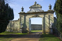 Classical stone gateway, driveway