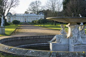 Classical fountain and pond, path leading to the Orangery