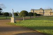 Classical statue on plinths, tree-lined avenue leading to Wrest Park House