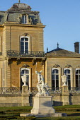 Classical statues and urns on plinths in front of Wrest Park House