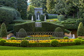 Clipped hedges in formal mediterranean garden, pansy bedding, view to Shepherd's Gate
