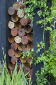 Insect 'hotel', wildlife habitat, old metal tin cans