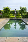 Formal pool with stone paved edge
