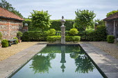 Formal pool with stone edging, gravel terrace