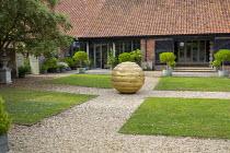 Formal courtyard garden, gravel path through lawns