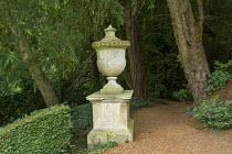 Stone urn on plinth