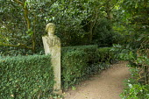 Minerva statue by woodland path