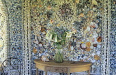 Table in Shell House, featuring shellwork by Blot Kerr Wilson, lilies in vase