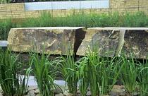 Pond, large boulders, stone chippings, grasses, Iris ensata, gabion wall