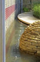 Bubbling water fountains, limestone path, dry stone gabion wall