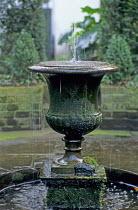 Fountain in classical urn