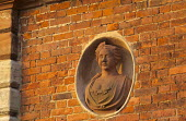 Facade of the orangery, terracotta bust in wall niche