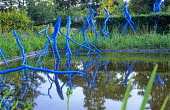Blue twigs sculpture in pond