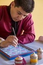 Calligrapher Hicham Ad painting arabesque pattern